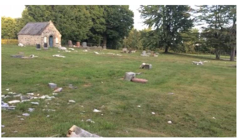Image from video of destruction in Maplewood Anglican Cemetery, Saint-Félix-de-Kingsey. Drummondville Express, 2014.